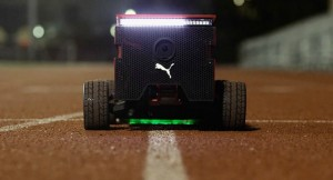 Amazing Puma robot keeps pace with Usain Bolt